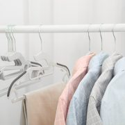 Teus Plastic Clothes Hanger on Rack